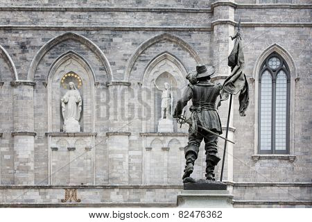 Detail of the exterior of the Basilica Notre Dame, with statue of Paul de Chomedey de Maisonneuve, founder of Montreal. In Old Town, Montreal, Canada.