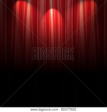 red theater curtain with soft lighting darkened bottom