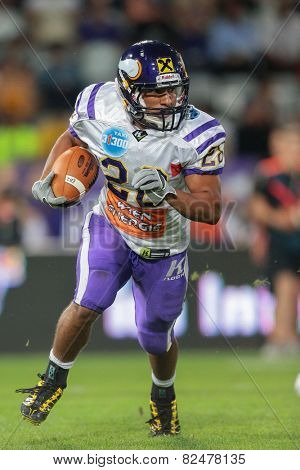 INNSBRUCK, AUSTRIA - JULY 6 RB Jesse Lewis (#28 Vikings) runs with the ball at Euro Bowl XXVII on July 6, 2013 in Innsbruck, Austria.