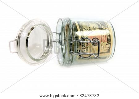 dollars in a glass container