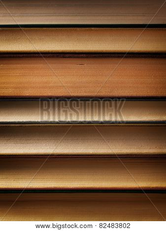 Concept background made of old books arranged in well-ordered close stacks