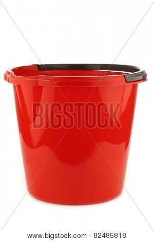 empty red plastic household bucket with a grey handle on a white background
