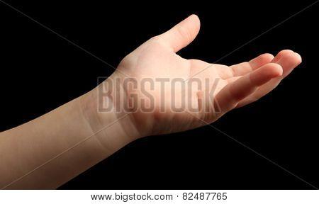 Child hand on black background