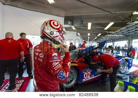 Daytona, FL - Jan 10, 2015:  Kyle Larson (02) straps in before taking to the track for the The Roar Before The 24 at Daytona International Speedway in Daytona, FL.