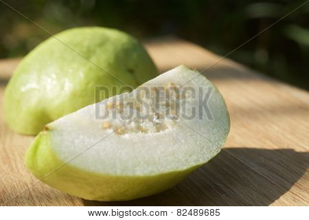 Piece of guava on table