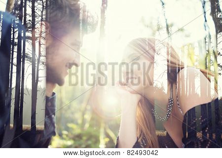 Young couple enjoying in beautiful park at river before sunset double exposure