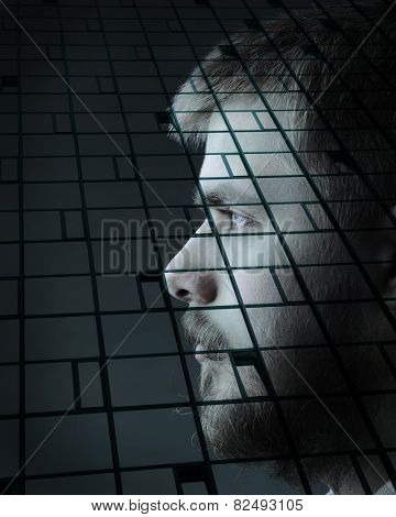 Portrait of young man with beard on double exposure building side