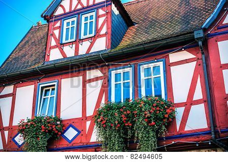 Red and blue half-timbered house in Buedingen, Germany