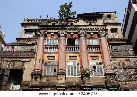 KOLKATA, INDIA - NOVEMBER 28: An aging, decaying, ex-colonial tenement block in Kolkata, West Bengal, India on November 28, 2012.