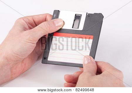 Female Hands Holding Floppy Disk