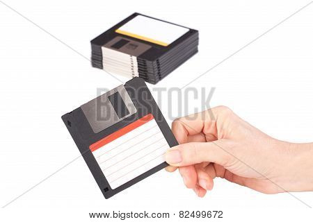 Female Hand Holding Floppy Disk