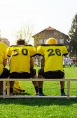 image of substitutes  - College football team substitutions sitting on the bench - JPG