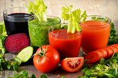 pic of juices  - Glasses with fresh organic vegetable juices on wooden table - JPG