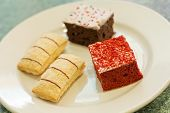 image of jimmy  - Assortment of sweet and colorful dessert cakes on a plate - JPG