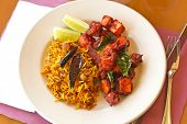 picture of crispy rice  - Crispy spicy Kadai Paneer Tofu with tamarind rice and lime wedges - JPG