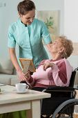 stock photo of handicap  - Image of nurse caring about handicapped woman - JPG