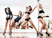 stock photo of pole dancer  - Four young sexy pole dance women - JPG