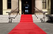 stock photo of front-entry  - Red carpet laid in front entrance of a luxury hotel building - JPG