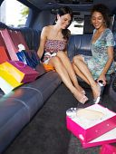 picture of limousine  - women in limousine trying on new shoes - JPG