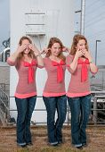 stock photo of evil  - Woman doing the tradition see no evil hear no evil speak no evil gesture - JPG