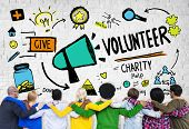 stock photo of huddle  - Volunteer Charity and Relief Work Donation Help Concept - JPG