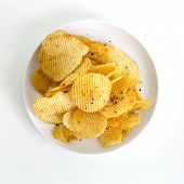 picture of potato chips  - Potato chips isolated in white plate on white background - JPG
