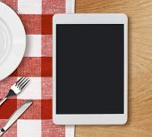 picture of knife  - tablet pc looking lioke ipad on dinner table with fork and knife - JPG
