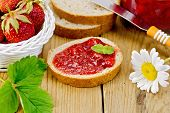 stock photo of jar jelly  - Bread with strawberry jam - JPG