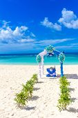 image of wedding arch  - beautiful decorated wedding arch on sand beach - JPG