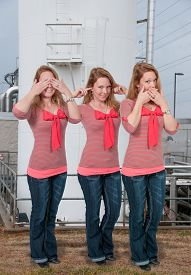picture of evil  - Woman doing the tradition see no evil hear no evil speak no evil gesture - JPG