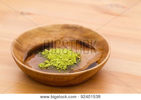 Japanese confectionery with green tea powder and black sugar sauce