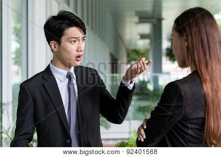Businessman argue with his assistant