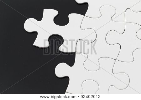 Puzzle over black background