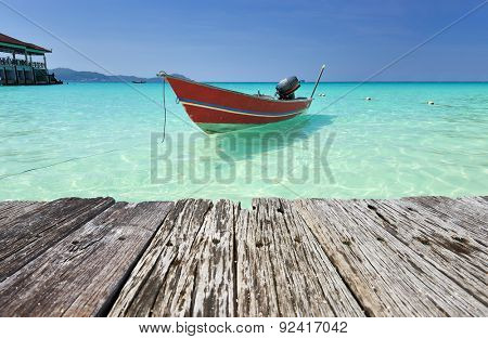 Beautiful beach with motor boat at Perhentian islands, Malaysia