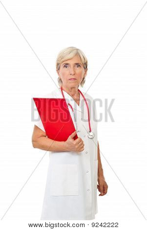 Serious Aged Doctor With Clipboard
