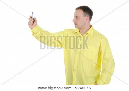 Man With The Phone In His Hand.