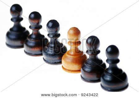 White pawn standing out in a row of black pawns , isolated on white , selective focus