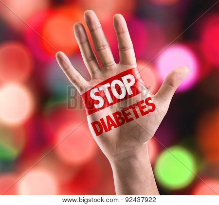 Open hand raised with the text: Stop Diabetes with bokeh background