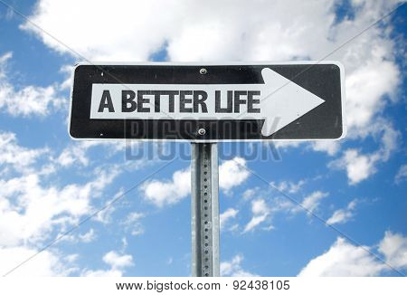 A Better Life direction sign with sky background