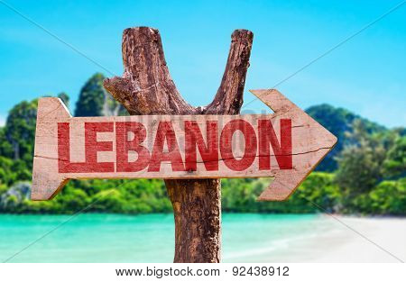 Lebanon wooden sign with coast background