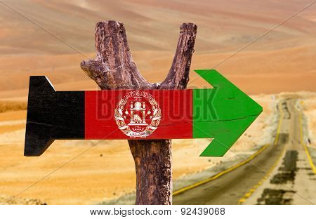 Afghanistan Flag wooden sign with desert background