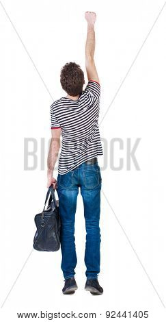Back view man with bag. Raised his fist up in victory sign. Rear view people collection.  backside view of person.  Isolated over white background. A guy in flying Superman pose with fashionable bag