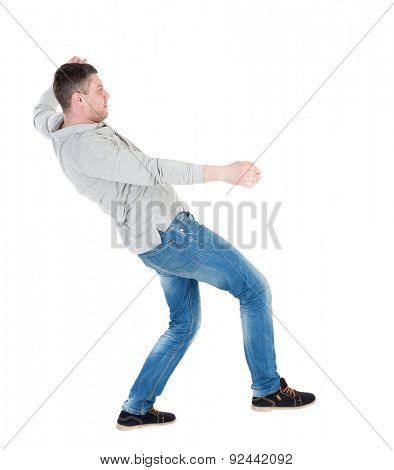 Balancing young man or dodge falling man. Rear view people collection.  backside view person. Isolated over white background. Man blows wind. Man swinging on his left leg and trying not to fall back.