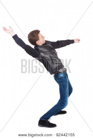 Balancing young man or dodge falling man. Rear view people collection. backside view person. Isolated over white background. Man blows the wind. guy in the leather jacket falls on his back. side view.