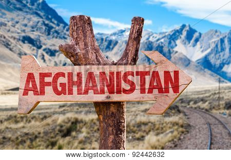 Afghanistan wooden sign with desert road background