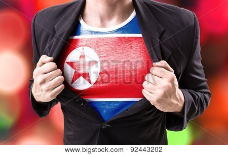 Businessman stretching suit with North Korea Flag on bokeh background