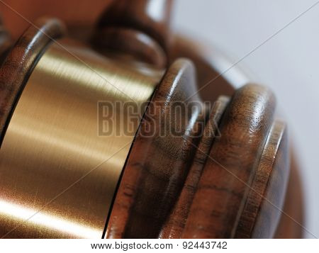 Judge gavel and paper sheet on wooden background. Close up