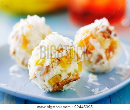 tropical cheese balls with dried fruit and coconut flakes