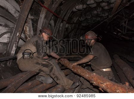 Donetsk, Ukraine - August, 16, 2013: Miners Sawn Timber For The Construction Of Roof Support In Unde