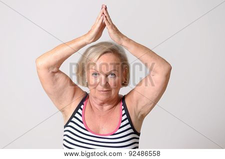 Middle Aged Woman Showing Two Hands Up